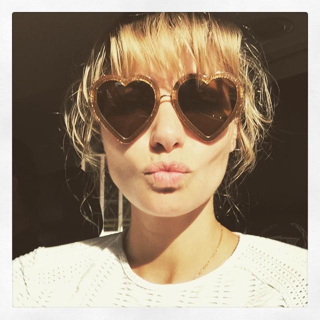Jessica Hart shares a photo with heart-shaped sunglasses