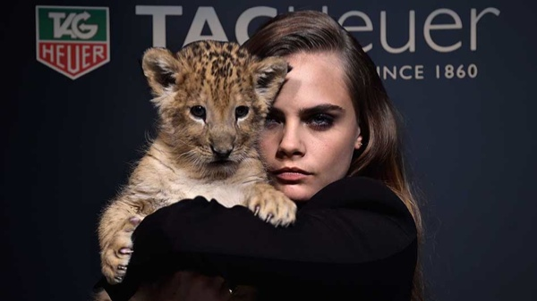 Cara Delevingne Stars in New TAG Heuer Ads & Poses with a Lion Cub