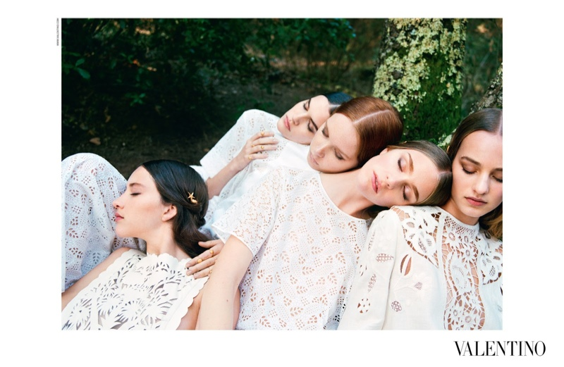Models wear Valentino white lace looks for the brand's spring-summer 2015 advertising campaign.