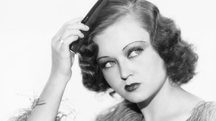 Romantic waves were a major part of 1930s hairstyles. Photo: Deposit Photos