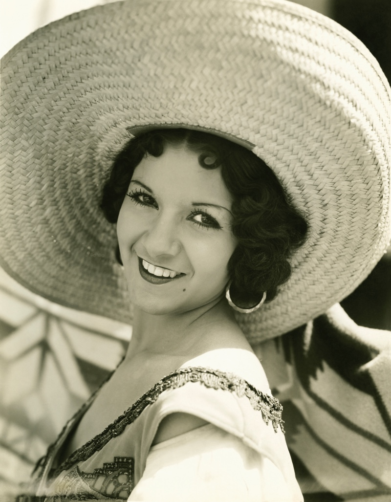 A woman wears thick curls underneath a sun hat in the 1930's. Photo: Deposit Photos