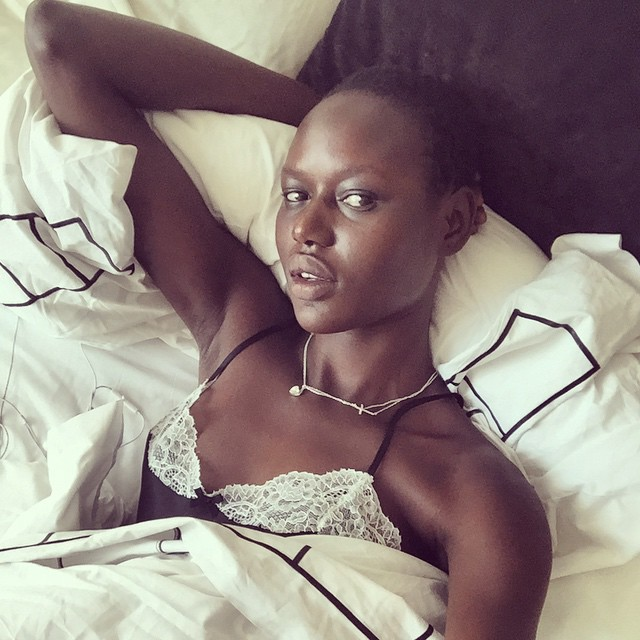 Ajak Deng lays in bed