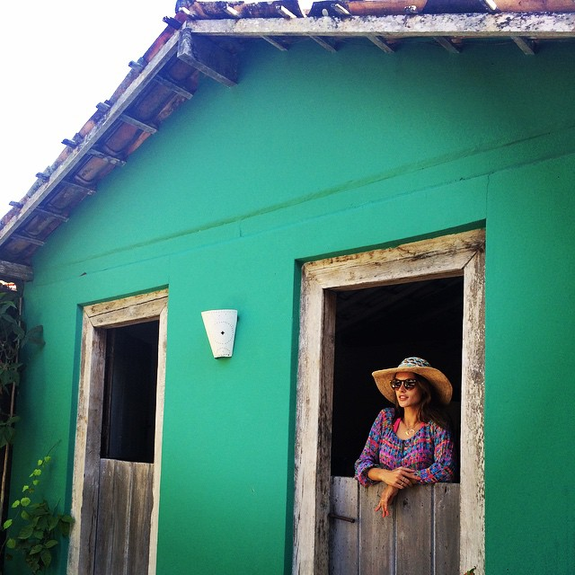 Alessandra Ambrosio poses in a quaint house