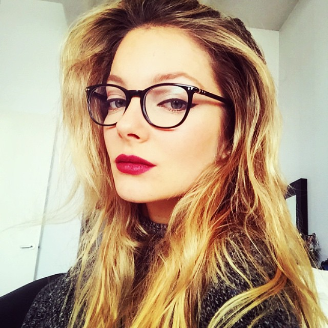 Eniko Mihalik looks thoughtful in her glasses