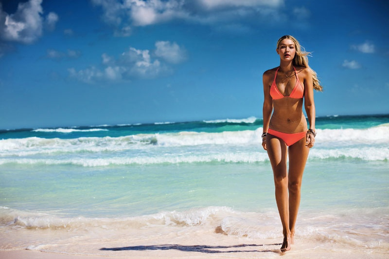 Gigi Hadid models a orange bikini in Seafolly Swim 2015 advertisement
