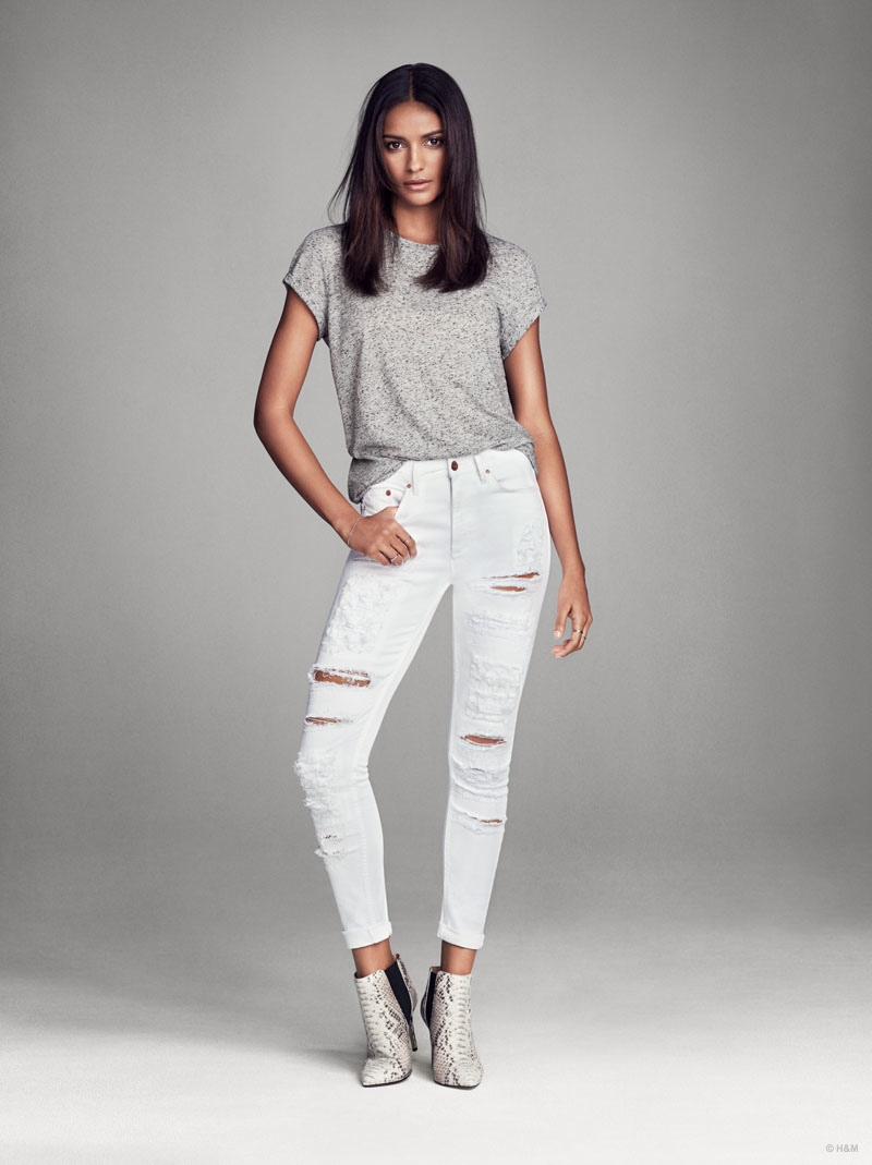Gracie Carvahlo models H&M white skinny jeans with ripped detailing.