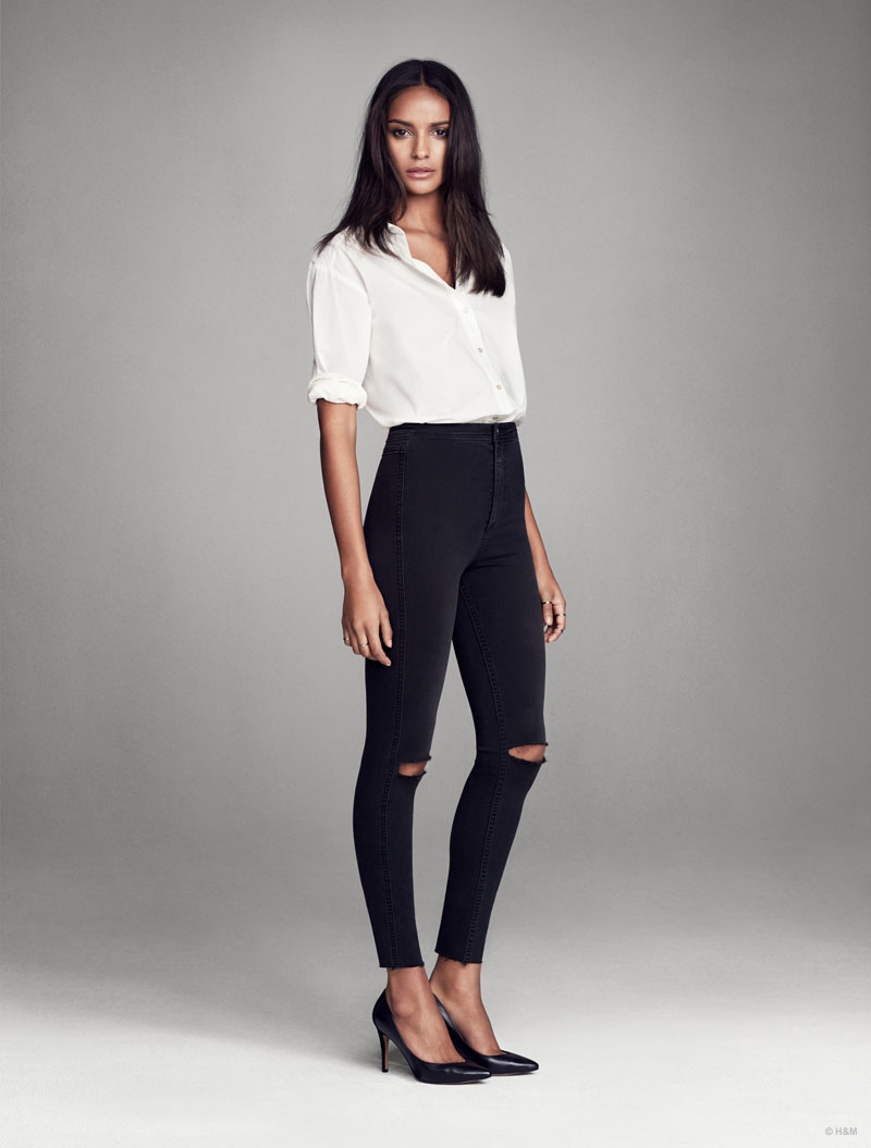Gracie Carvahlo wears black skinny jeans featuring a high-waist for H&M.