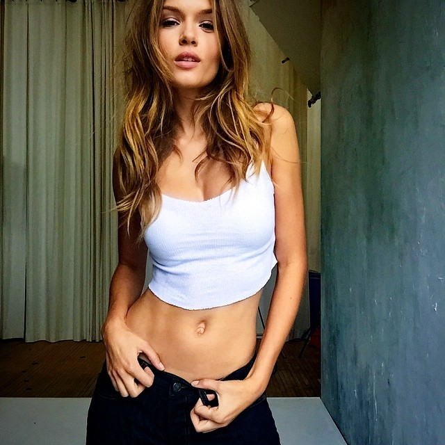 Josephine Skriver rocks a white tee and jeans