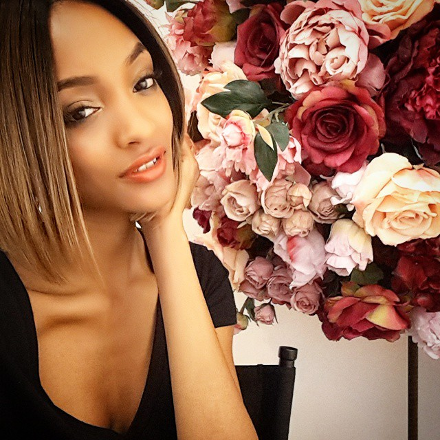 Jourdan Dunn poses with a lovely arrangement of flowers