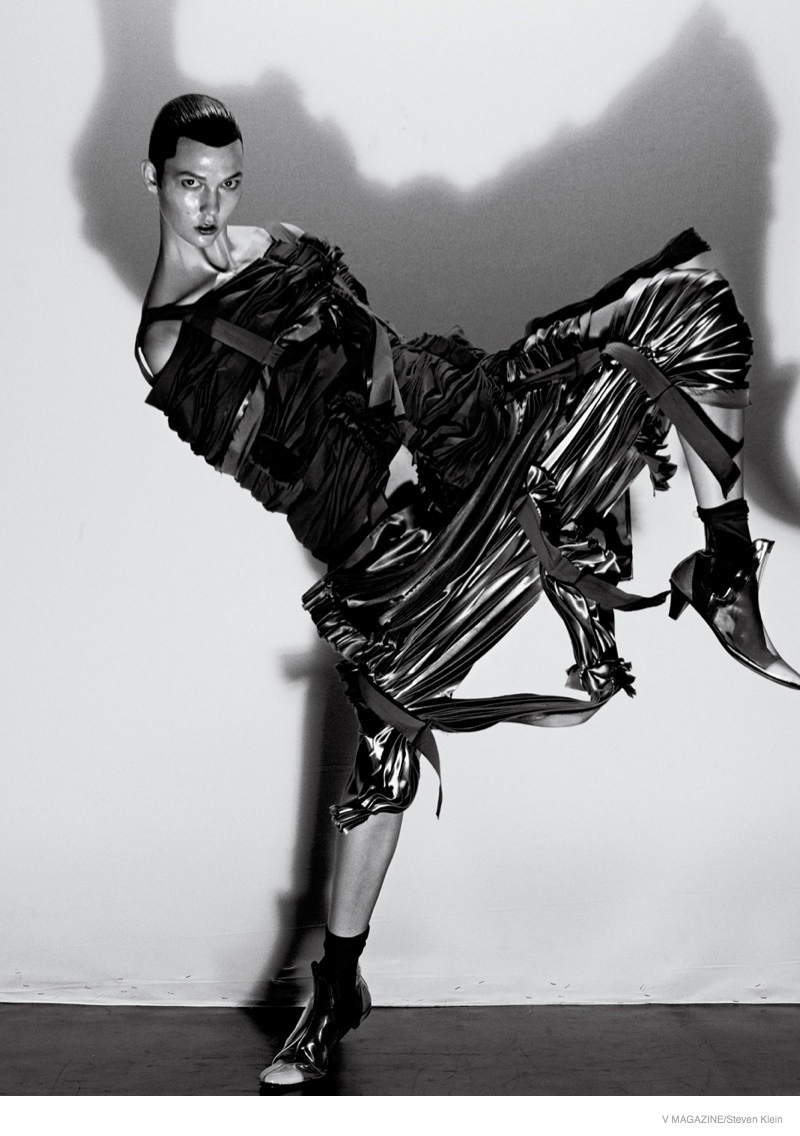 Karlie Kloss shows off her signature posing skills in this black and white image