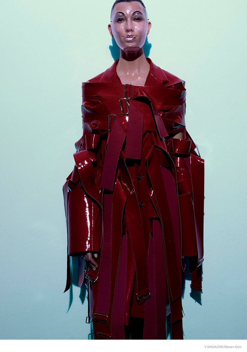 The American model gets covered up with a see-through mask and all red ensemble from Comme des Garçons