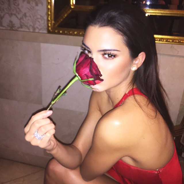 Kendall Jenner poses with a rose
