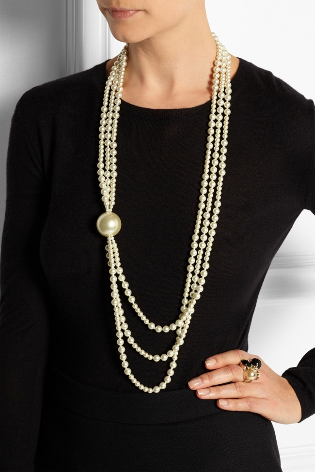 This Kenneth Jay Lane Faux Pearl necklace pays homage to Baker's love of the stone.
