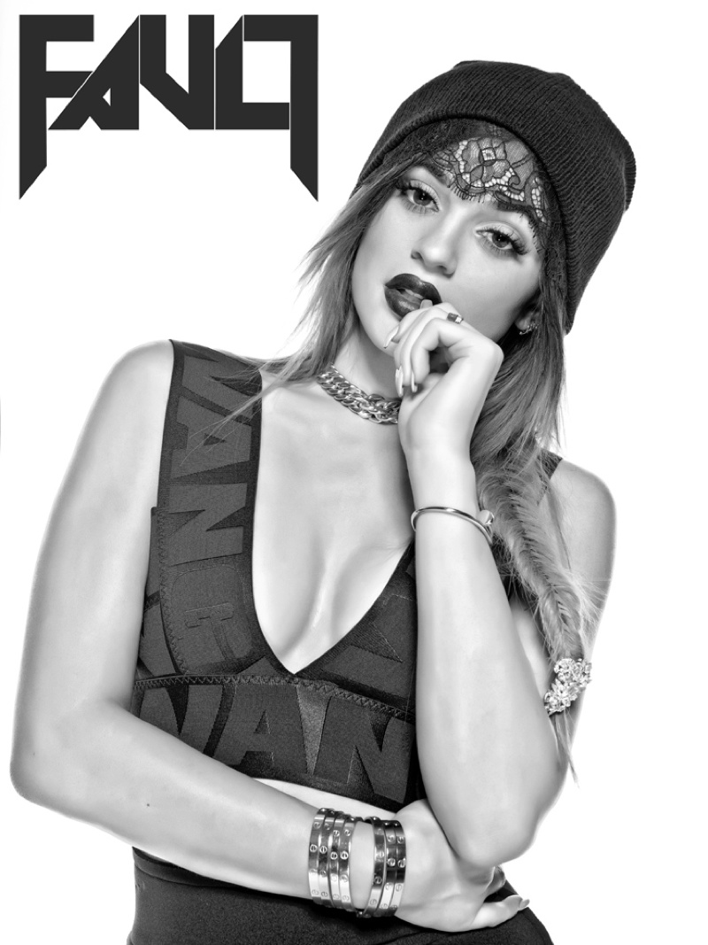 Kylie wears a lace trimmed headpiece and Alexander Wang top in a black and white image.
