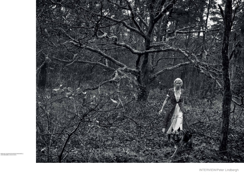 In the woods, she models Maison Margiela and Hermes