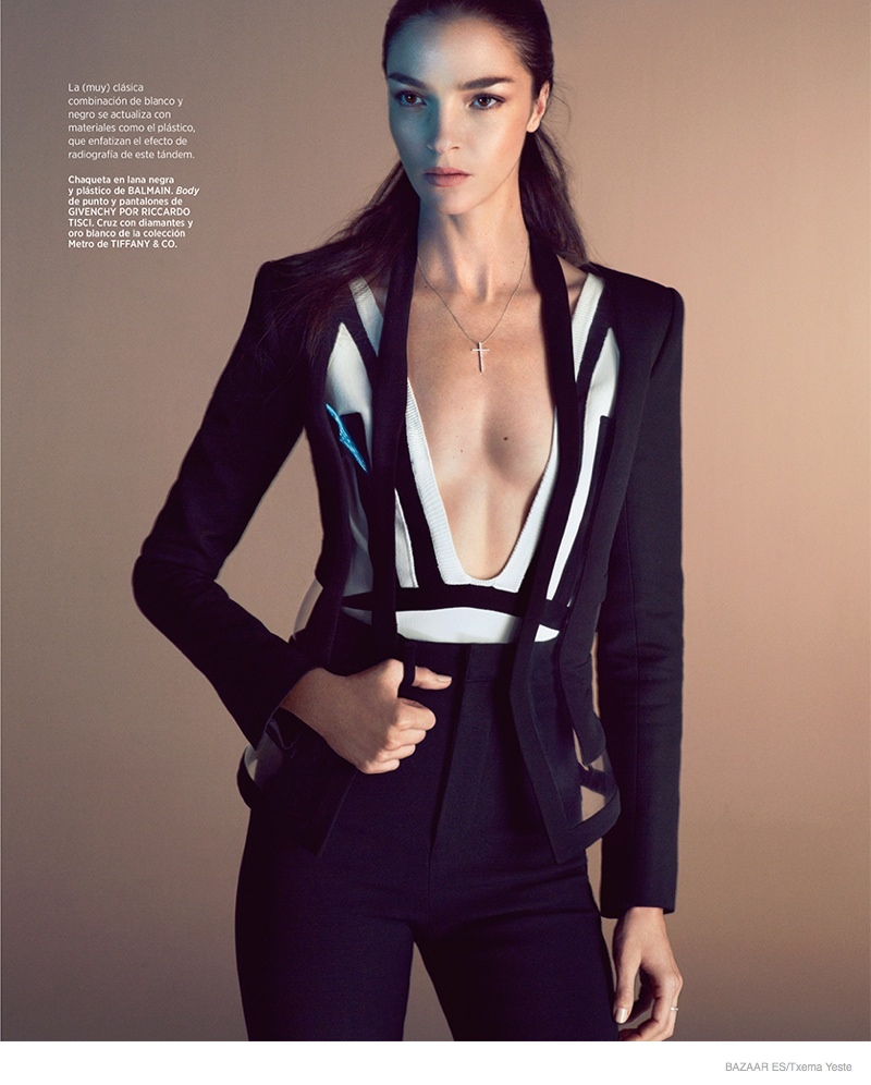 The Italian model reveals her svelte physique in a Balmain suit with a Givenchy top in black and white.