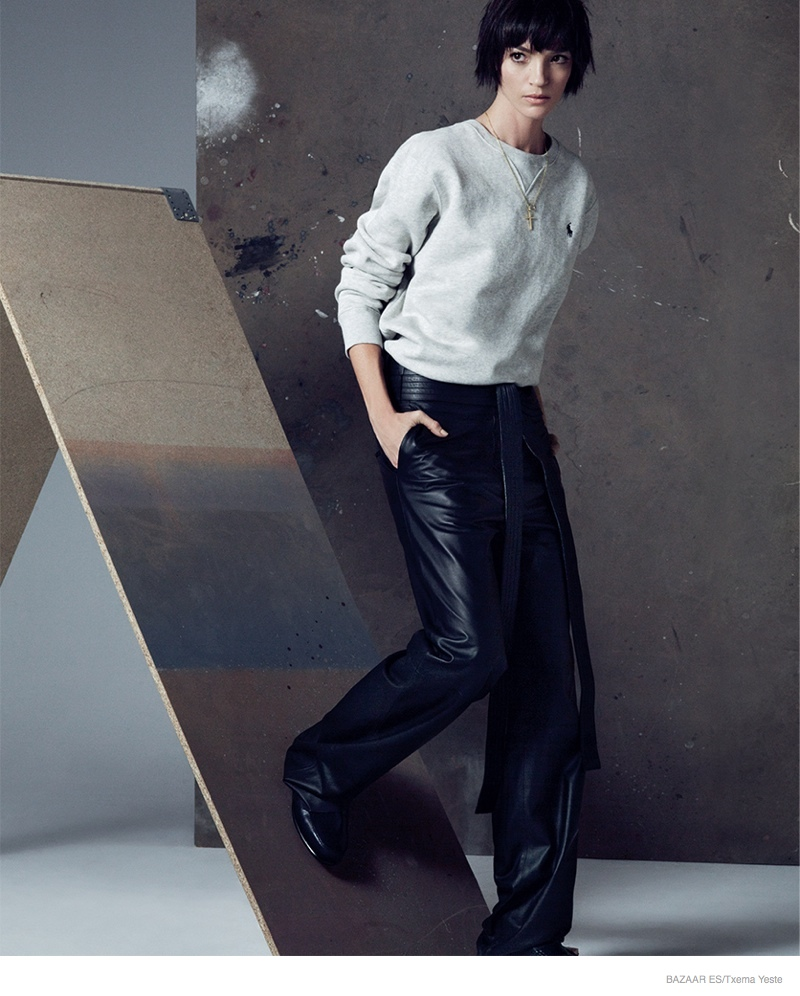 Mariacarla's androgynous side shines through with a short hairstyle and sweater + pants look.