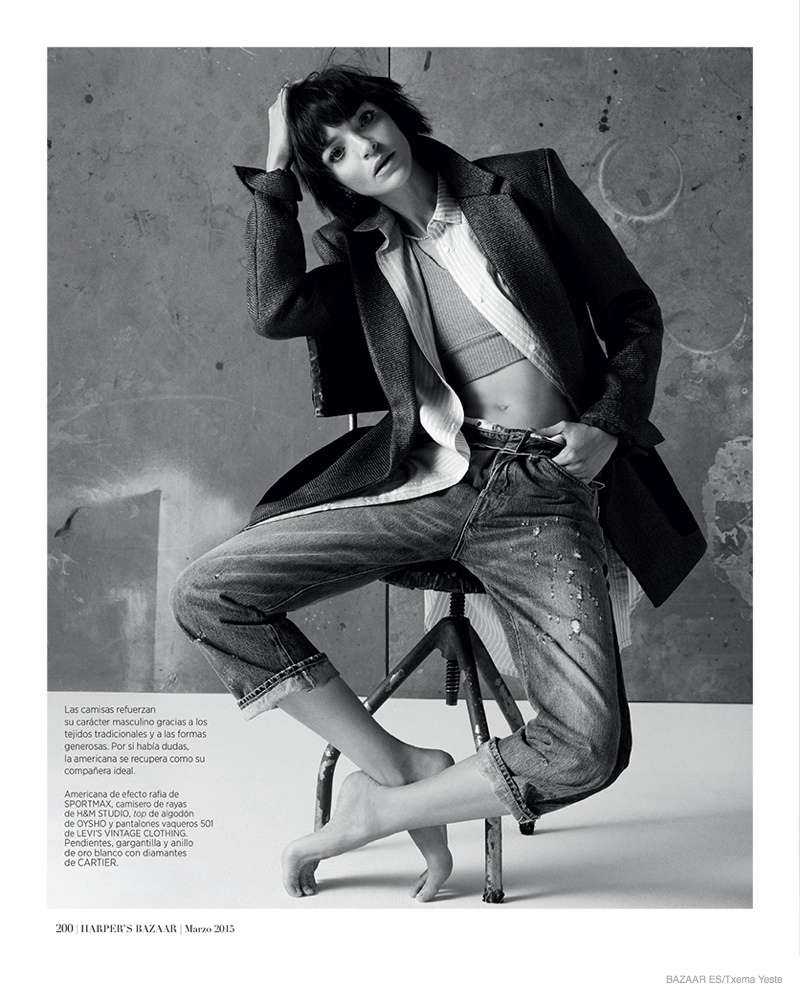 The brunette layers in cropped denim jeans, a coat, top and cropped sweater in the fashion feature.