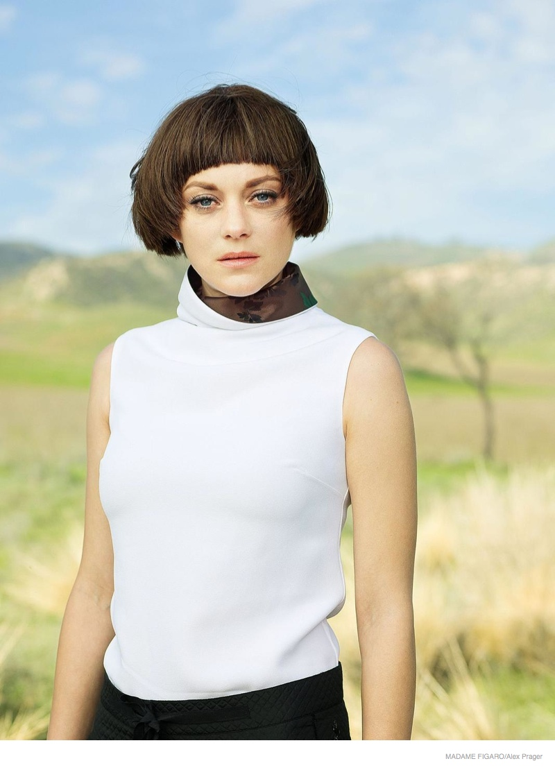 Marion Cotillard gives an intense gaze to the camera for the fashion feature.