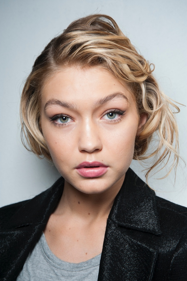 Gigi Hadid with a messy updo channeling 1950s beauty at the Max Mara Fall 2015 show.