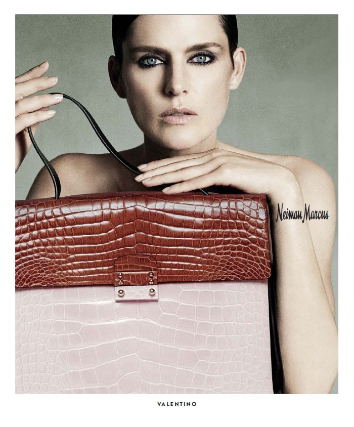 A bag from Valentino is spotlighted.