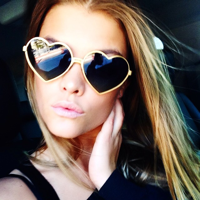 THROW ON SOME SHADES: Don't like how you look in a selfie? Throw on some shades for the ultimate accessory making statement like Sports Illustrated Swimsuit model Nina Agdal. Photo via Instagram.