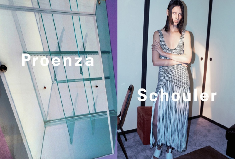 Adorned with a fringe skirt, the Proenza Schouler woman poses with her arms crossed for spring 2015.