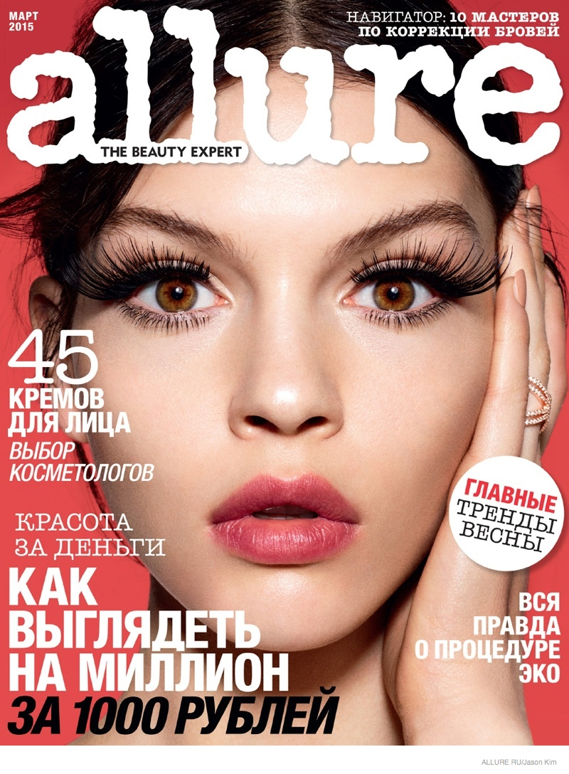 Kate Bogucharskaia reveals bold eyelashes and a coral pout on the March 2015 cover from Allure Russia photographed by Jason Kim.