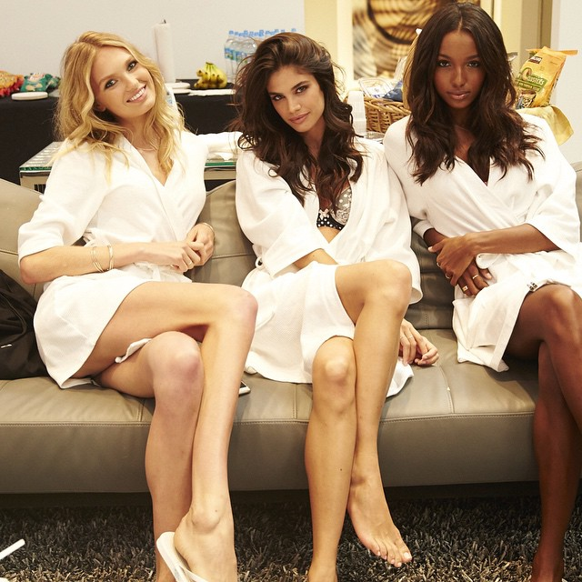 Romme Strijd, Sara Sampaio and Jasmine Tookes pose in robes at Victoria's Secret