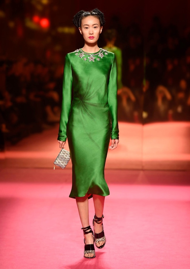 In recent years the Schiaparelli brand has been revamped. A look from the spring 2015 haute couture collection features strong shoulders and a feminine silhouette.
