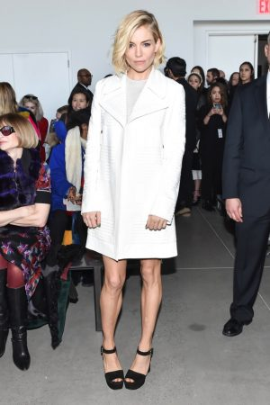 Sienna Miller Wears Calvin Klein Collection Leather Jacket + Knit Dress at NYFW