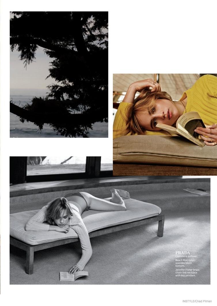 Suki lounges in Prada pullover