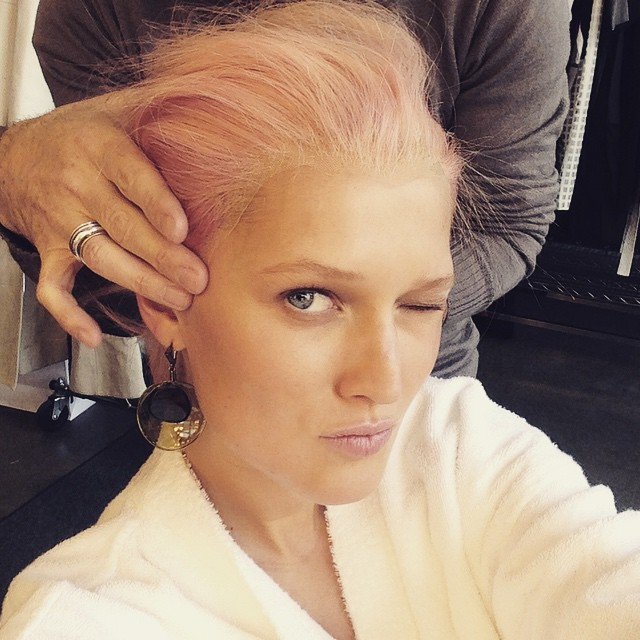 Toni Garrn tries on a pink hairstyle