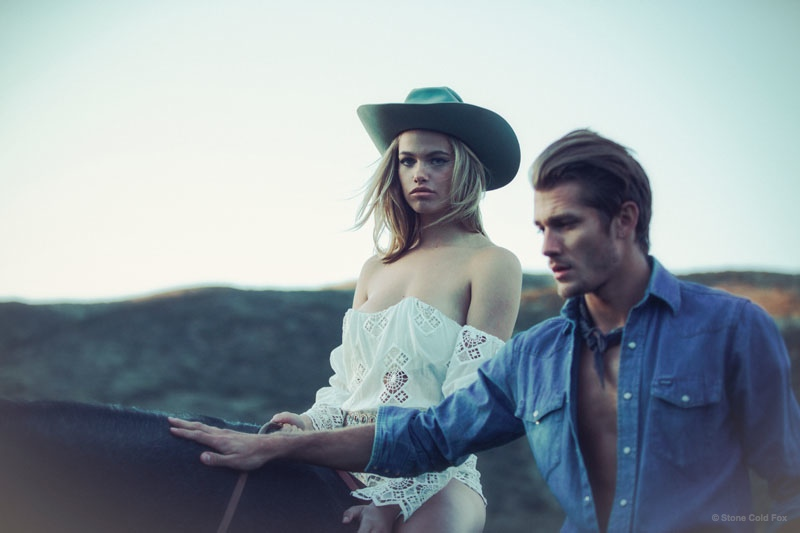 Posing next to a hunky ranch hand, Hailey looks ethereal in white