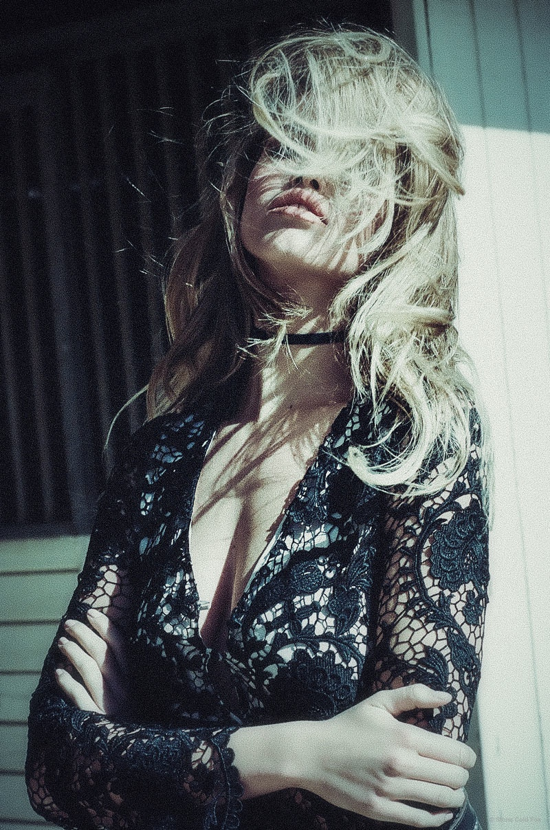A sexy lace top adds some mystique.