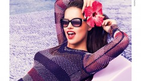 Wearing red lipstick, a flower in her hair and cool shades--Adriana is in Vogue. Vogue Eyewear, that is!