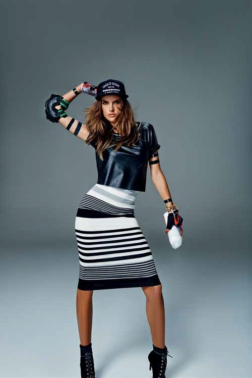 Alessandra rocks some black and white stripes as well as a leather crop top