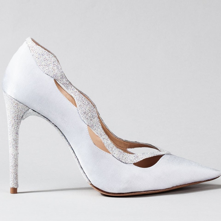 Alexandre Birman created a shoe that was a reinterpretation of the classic 'Johanna' pump. In white with sparkles, it truly is a unique vision.