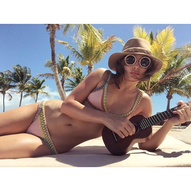 Alyssa Miller plays a ukele on the beach