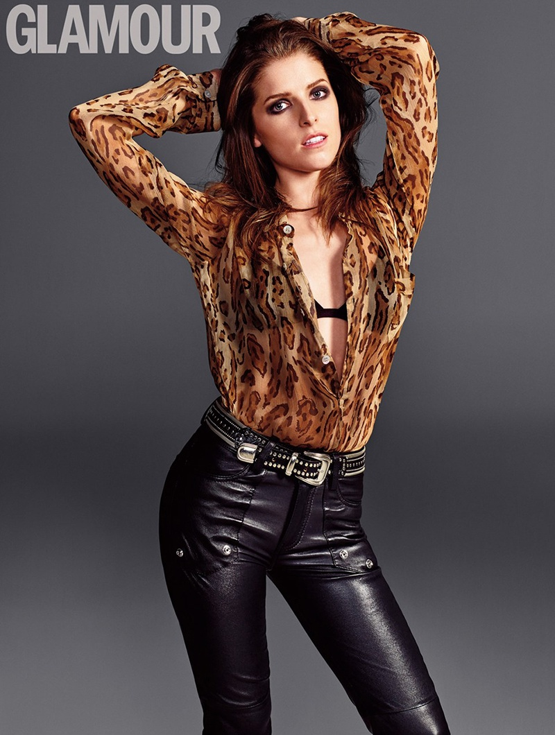 Anna sports leather pants, a black bra and sheer animal print blouse