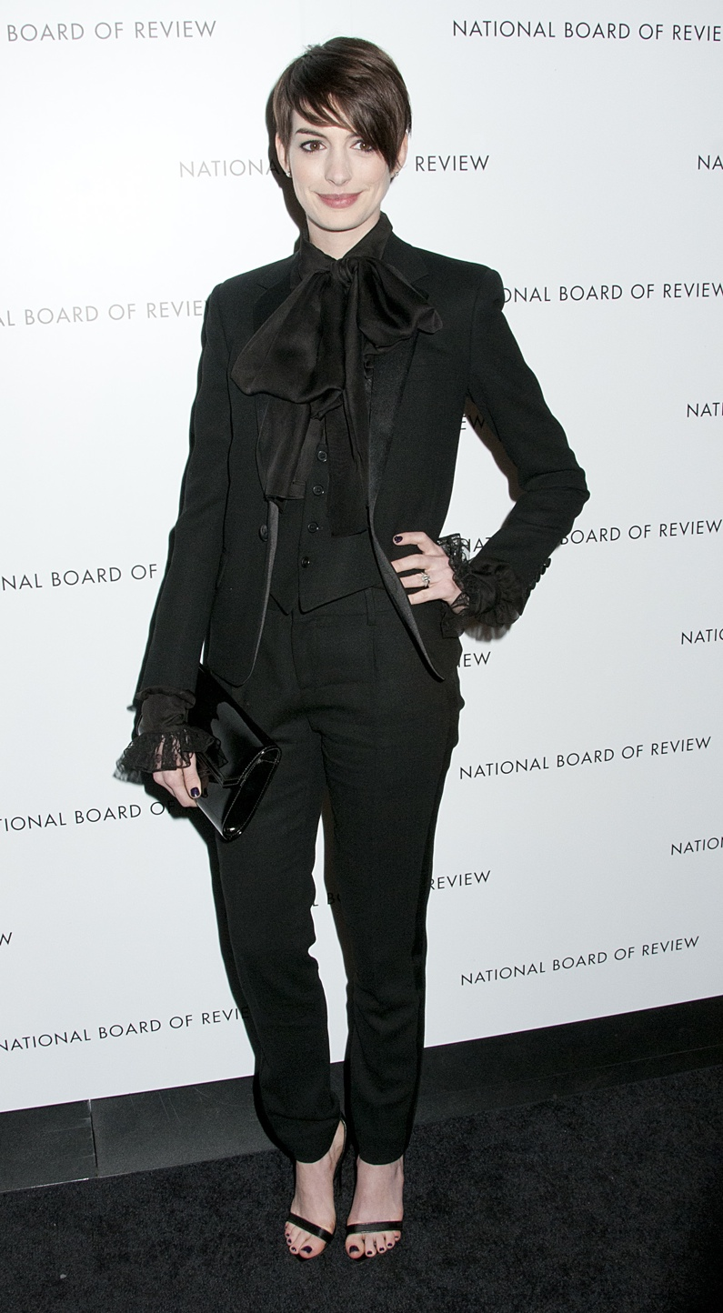 Anne Hathaway dons a Saint Laurent tuxedo pant suit in black with ruffled shirt. Photo: Janet Mayer / PRPhotos.com