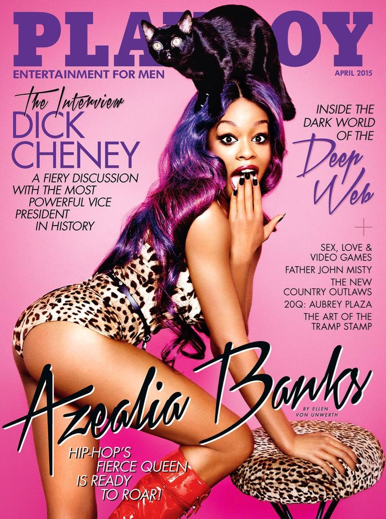 Rapper Azealia Banks poses on the April 2015 cover from Playboy Magazine. She poses with a cat on her head with a leopard print bodysuit.