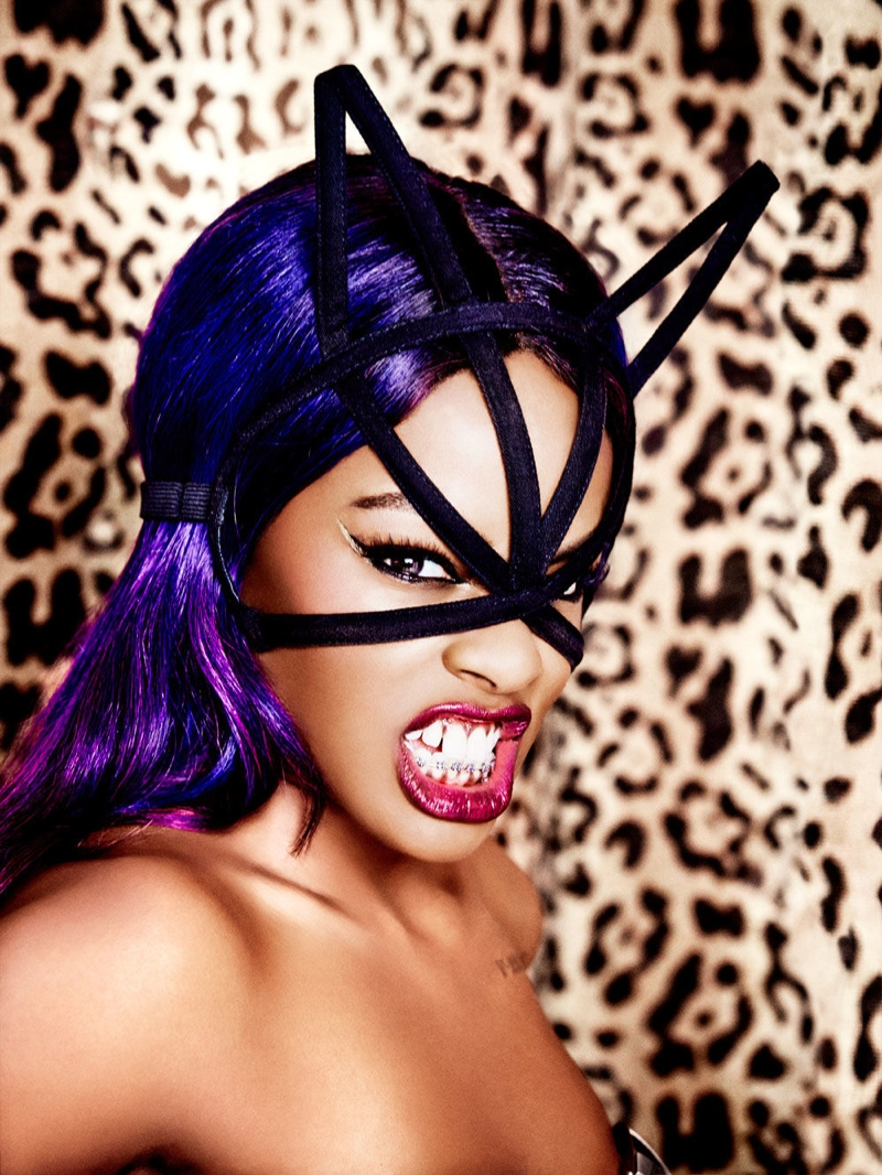 The controversial rapper looks ready to roar with a cat mask and purple hair.