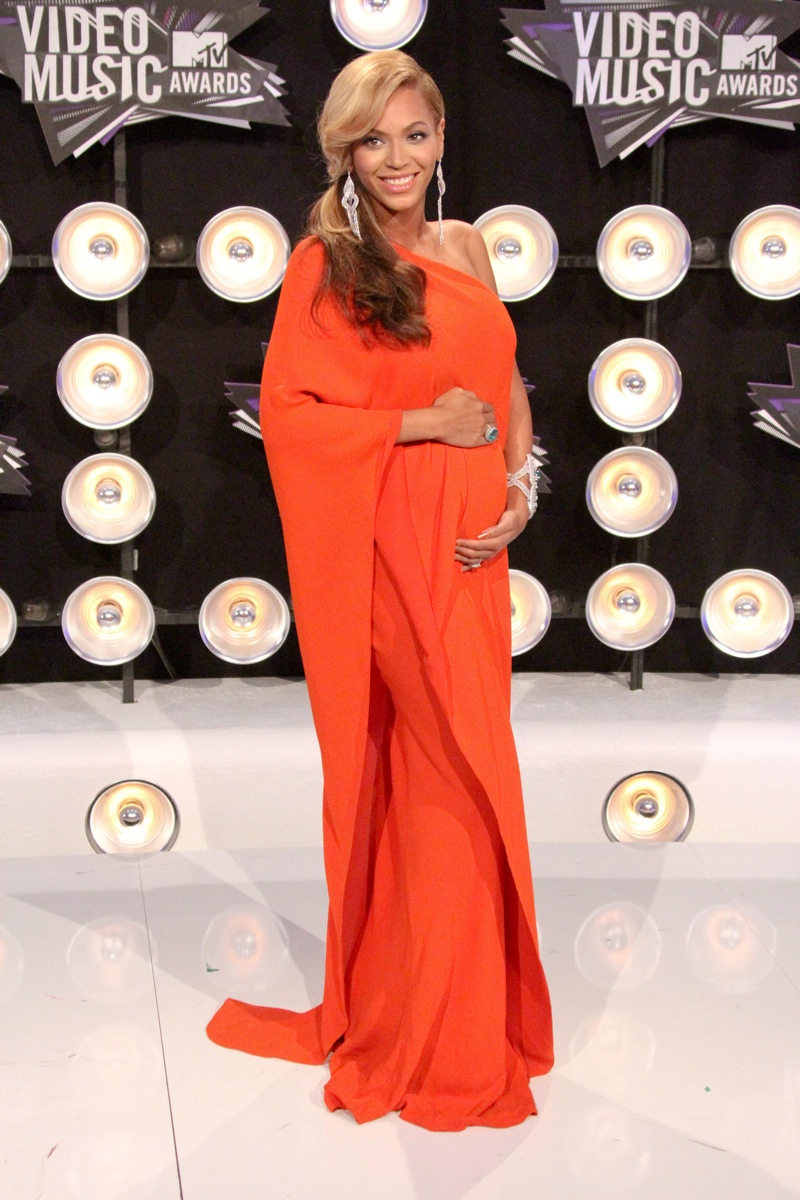 Maternity dresses on the red carpet photo shutterstock wearing maternity style beyonce looks stunning in a draped lanvin dress in orange in 2011 ombrellifo Gallery