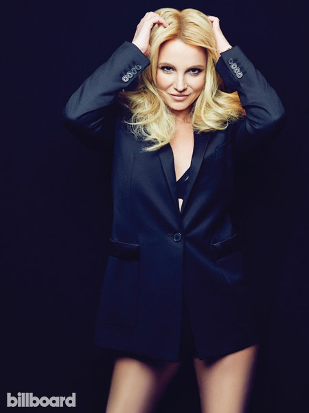 Wearing a black shirt and bra, Britney strips down for the camera.