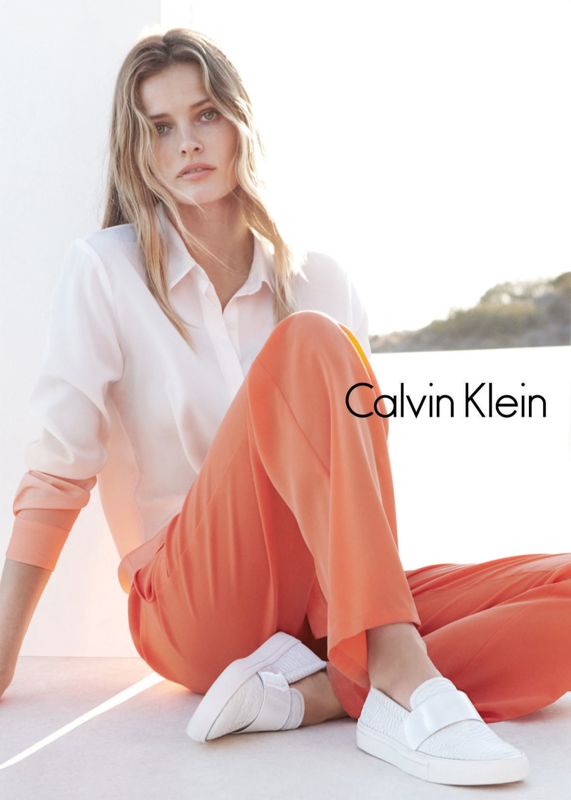 A crisp white shirt paired with coral pants makes a statement.