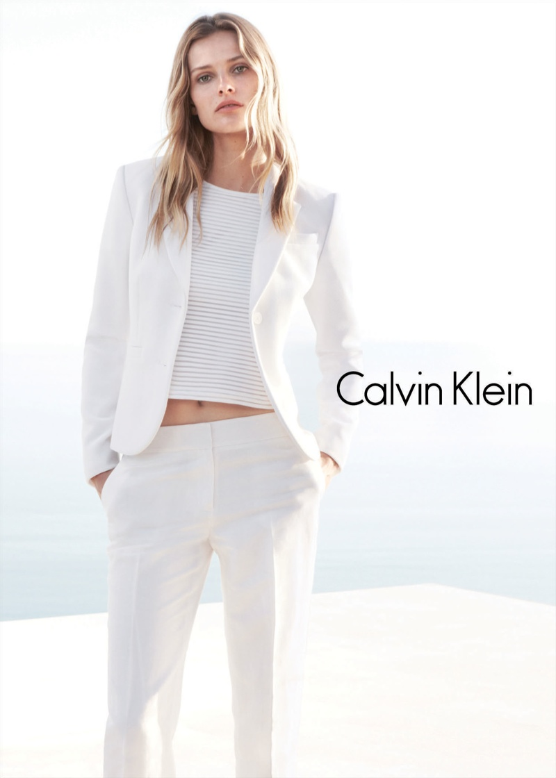 Edita Vilkeviciute suits up in an all white look.