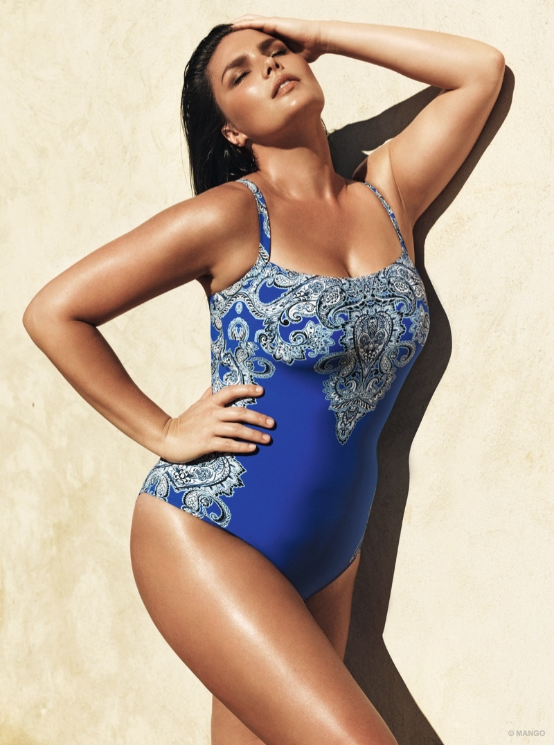 Rocking a tanned glow, Candice wows in a blue one-piece swimsuit from Violeta.