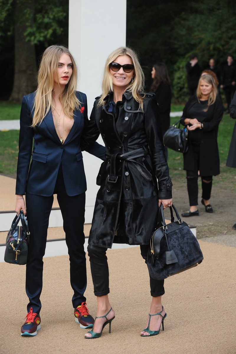 Cara Delevingne wears a Burberry pant suit with sneakers at the Burberry spring 2015 womenswear show. Photo: Landmark / PR Photos