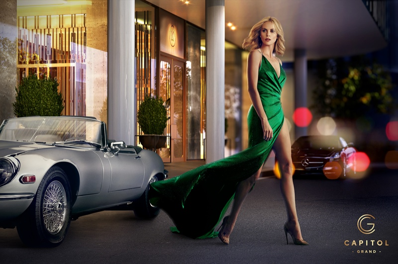 Charlize flaunts her famous legs in a green gown with a high slit